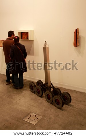 MILAN, ITALY - MARCH 27: People look at modern art examples at MiArt ArtNow, international exhibition of modern and contemporary art March 27, 2010 in Milan, Italy.