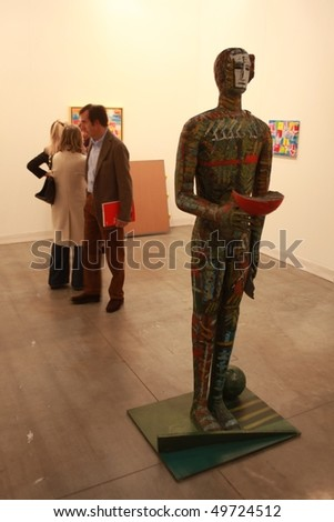 MILAN, ITALY - MARCH 27: People look at works of art at MiArt ArtNow, international exhibition of modern and contemporary art March 27, 2010 in Milan, Italy.