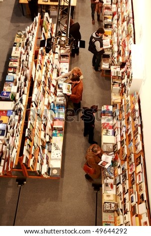 MILAN, ITALY - MARCH 27: People look for art books at MiArt ArtNow, international exhibition of modern and contemporary art March 27, 2010 in Milan, Italy.