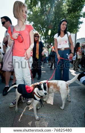MILAN, ITALY - MAY 8: A group of dog lovers and their pets attend a demonstration against \