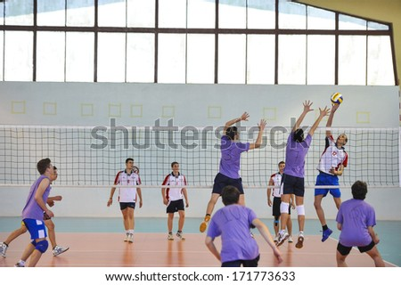 MILAN, ITALY - MAY 27: College male students competing during a volleyball school final in MilanMay 27 ,2013.