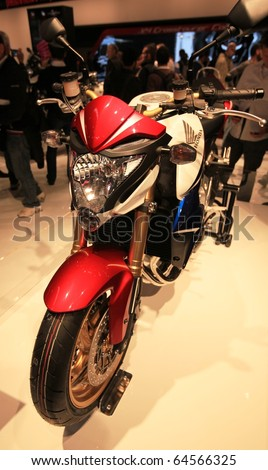 MILAN, ITALY - NOV. 03: Close-up on Honda motorcycle in exhibition at EICMA, 68th International Motorcycle Exhibition November 03, 2010 in Milan, Italy.