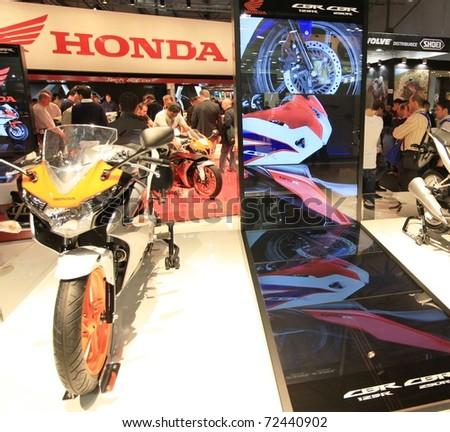 MILAN, ITALY - NOV. 03: Details of Honda motorcycle pavilion exhibition at EICMA, 68th International Motorcycle Exhibition November 03, 2010 in Milan, Italy.