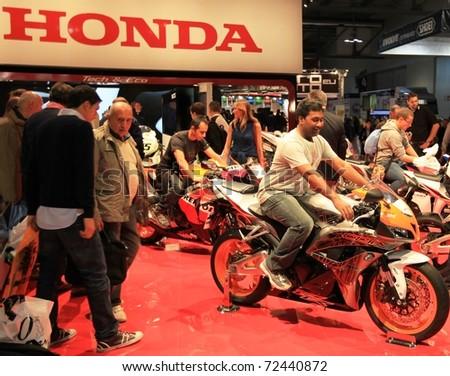MILAN, ITALY - NOV. 03: Details of Honda motorcycles in exhibition at EICMA, 68th International Motorcycle Exhibition November 03, 2010 in Milan, Italy.
