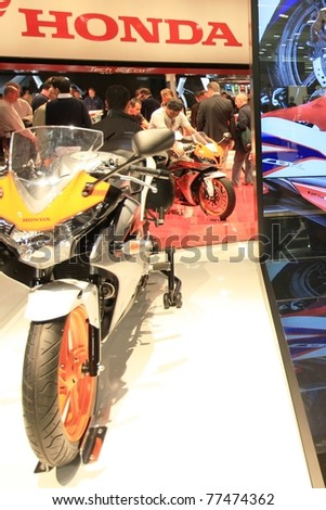 MILAN, ITALY - NOV. 03: Details of new Honda motorcycles stand in exhibition at EICMA, 68th International Motorcycle Exhibition November 03, 2010 in Milan, Italy.