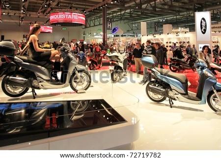 MILAN, ITALY - NOV. 03: Looking at brand new Honda motorcycles in exhibition at EICMA, 68th International Motorcycle Exhibition November 03, 2010 in Milan, Italy.
