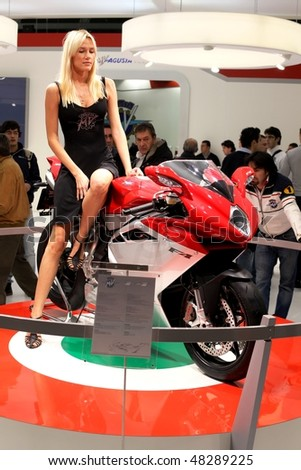 MILAN, ITALY - NOV. 11: Model presenting F4 Agusta at EICMA, 67th International Motorcycle Exhibition November 11, 2009 in Milan, Italy.