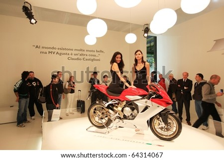 MILAN, ITALY - NOV. 03: People look at Agusta Motorcycles Art stand in exhibition at EICMA, 68th International Motorcycle Exhibition November 03, 2010 in Milan, Italy.