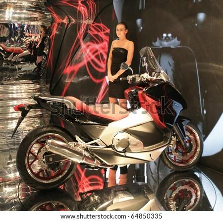 MILAN, ITALY - NOV. 03: Top model at Honda motorcycles area during EICMA, 68th International Motorcycle Exhibition November 03, 2010 in Milan, Italy.