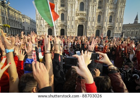 MILAN, ITALY- NOVEMBER 10: Laura Pausini sings in Piazza Duomo in Milan November 10, 2011. Laura Pausini, famous italian singer, presents her last album 'INEDITO' by flash mob in Milan Piazza Duomo