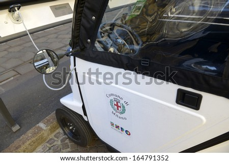 MILAN, ITALY - NOVEMBER 27: public electric car recharging a parking spot, November 27, 2013 in Milan, Italy.