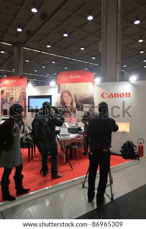MILAN, ITALY - OCT. 19: Interview at Canon technologies stand at SMAU, international fair of business intelligence and information technology October 19, 2011 in Milan, Italy. - stock photo
