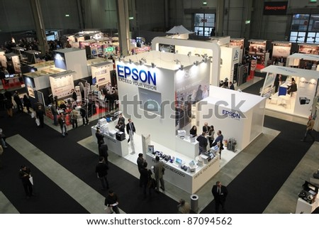 MILAN, ITALY - OCT. 19: Panoramic view of people visiting Epson technologies stand at SMAU, international fair of business intelligence and information technology October 19, 2011 in Milan, Italy.