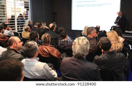 MILAN, ITALY - OCT. 19: People during a businness meeting at SMAU, international fair of business intelligence and information technology October 19, 2011 in Milan, Italy.