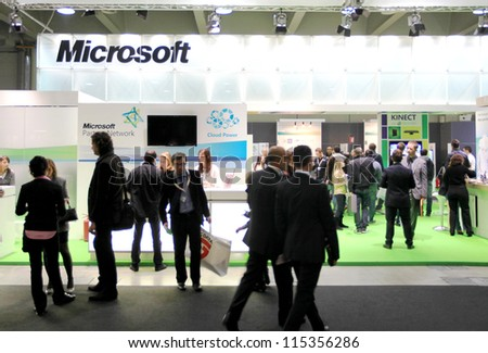 MILAN, ITALY - OCT. 19: People visit Microsoft technologies exhibition area at SMAU, international fair of business intelligence and information technology October 19, 2011 in Milan, Italy.