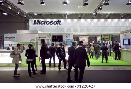 MILAN, ITALY - OCT. 19: People visit Microsoft technologies stands at SMAU, international fair of business intelligence and information technology October 19, 2011 in Milan, Italy.