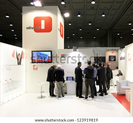 MILAN, ITALY - OCT. 20: People visit Olivetti products stands at SMAU, international fair of business intelligence and information technology October 20, 2010 in Milan, Italy.