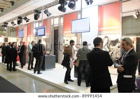 MILAN, ITALY - OCT. 19: People visit Telecom technologies stands at SMAU, international fair of business intelligence and information technology October 19, 2011 in Milan, Italy.