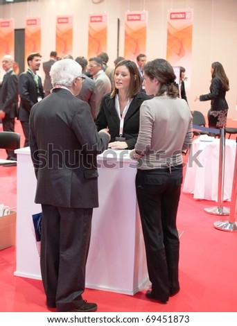 MILAN, ITALY - OCT. 21: People visiting office technology stands at SMAU, national fair of business intelligence and information technology October 21, 2009 in Milan, Italy.