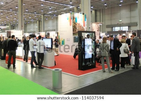 MILAN, ITALY - OCT. 19: People visiting technologies area during SMAU, international fair of business intelligence and information technology October 19, 2011 in Milan, Italy.