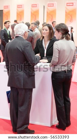 MILAN, ITALY - OCT. 21: People visiting technologies exhibition stands at SMAU, national fair of business intelligence and information technology October 21, 2009 in Milan, Italy.