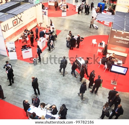 MILAN, ITALY - OCT. 21: People visiting technology stands at SMAU, national fair of business intelligence and information technology October 21, 2009 in Milan, Italy.
