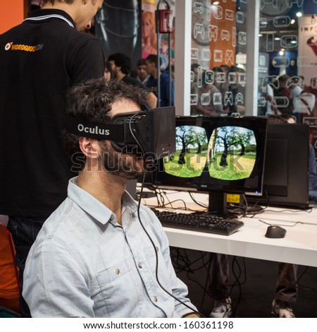 MILAN, ITALY - OCTOBER 26: Guy tries a virtual reality headset at Games Week 2013, event dedicated to video games and electronic entertainment on OCTOBER 26, 2013 in Milan.