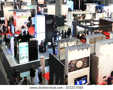 MILAN, ITALY - OCTOBER 20: Panoramic view of people visiting technologies stands at SMAU, international fair of business intelligence and information technology October 20, 2010 in Milan, Italy.