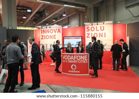 MILAN, ITALY - OCTOBER 17: People at Vodafone technologies products area at SMAU, international fair of business intelligence and information technology October 17, 2012 in Milan, Italy.