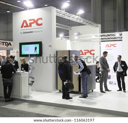 MILAN, ITALY - OCTOBER 17: People visit APC technology products exhibition area at SMAU, international fair of business intelligence and information technology October 17, 2012 in Milan, Italy.