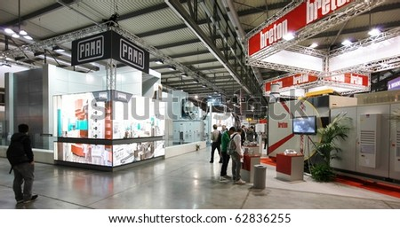 MILAN, ITALY - OCTOBER 08: People visit stands at Sfortec 2010, international exhibition of machines, robots, automation and auxiliary technologies October 08, 2010 in Milan, Italy. #62836255