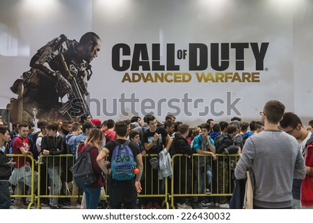 MILAN, ITALY - OCTOBER 24: People wait to enter Call of Duty stand at Games Week 2014, event dedicated to video games and electronic entertainment on OCTOBER 24, 2014 in Milan.