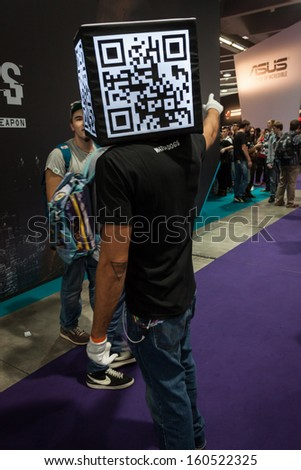 MILAN, ITALY - OCTOBER 26: Qr code head man at Games Week 2013, event dedicated to video games and electronic entertainment on OCTOBER 26, 2013 in Milan.