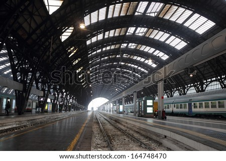 MILAN, ITALY - OCTOBER 22: the Central Train Station interior in a wide-angle view on October 22, 2013 in Milan, Italy. Milano Centrale is the Italian second-largest station.