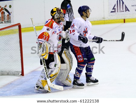 MILAN, ITALY - SEP 17: Regan Kevin of  HC Valpellice and Andrea Delfino of HC Milano during a game   at Agorà  Arena on September 17, 2010, in Milan