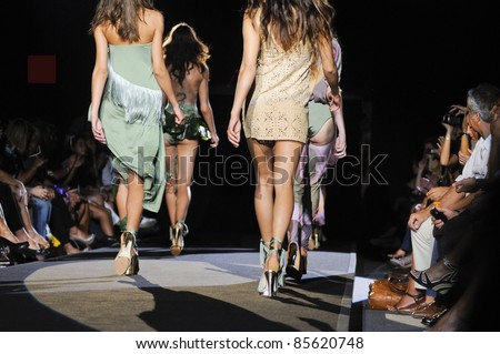 MILAN, ITALY - SEPTEMBER 25: Models walk the runway at woman fashion week in Milan, Italy on September, 25 2011. This is a fashion show of the collection AGOGOA which brings together famous and beautiful Italian women