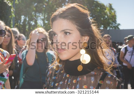 MILAN, ITALY - SEPTEMBER 24: People during Milan Fashion week, Italy on SEPTEMBER 24, 2015. Eccentric and fashionable people waiting for models and vips outside city during Milan fashion week #321215144