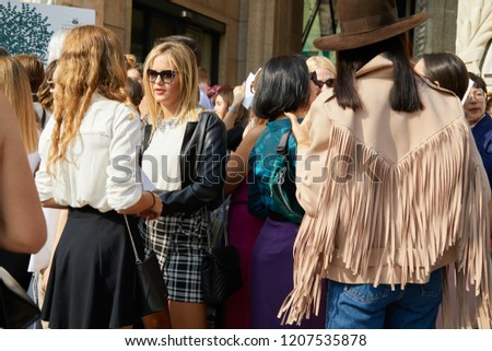 MILAN, ITALY - SEPTEMBER 20, 2018: People waiting before Genny fashion show, Milan Fashion Week street style #1207535878
