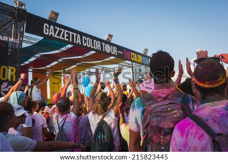 MILAN, ITALY - SEPTEMBER 6: Thousands of people take part in the Color Run event, the funniest and most colorful urban running ever on SEPTEMBER 6, 2014 in Milan.