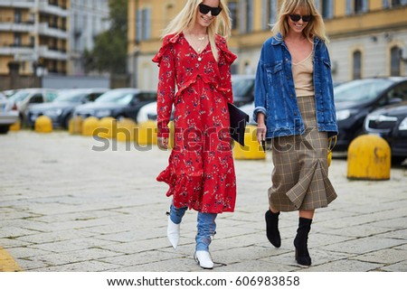 MILAN, ITALY - SEPTEMBER 21, Women arrive at Gucci fashion show during Milan Fashion Spring/Summer 2017