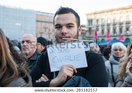 Milan, January 10, 2015 - Portrait of a young boy showing, with the words 'I'm Charlie', its solidarity for the victims of the terroristic attack in France. #281182157
