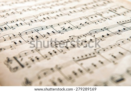 Milan, Lombardy, Italy - March 3, 2014-: Old yellowed aged music score