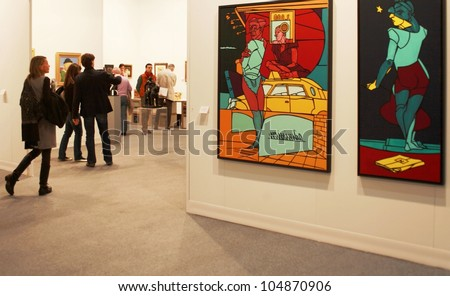 MILAN - MARCH 27: A woman enters paintings galleries during MiArt ArtNow, international exhibition of modern and contemporary art March 27, 2010 in Milan, Italy.