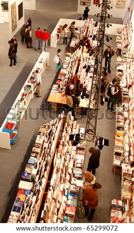 MILAN - MARCH 27: Panoramic view of people looking for art book at MiArt ArtNow, international exhibition of modern and contemporary art March 27, 2010 in Milan, Italy.
