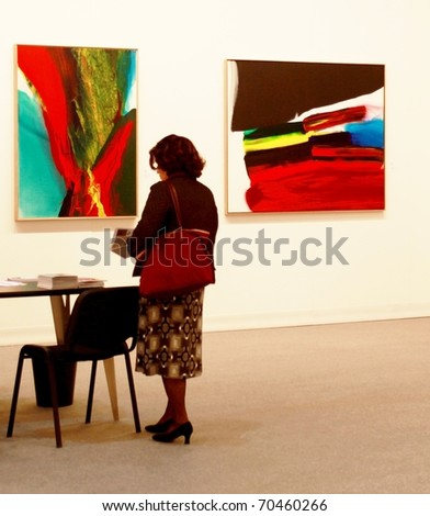 MILAN - MARCH 27: People look at arts galleries during MiArt ArtNow, international exhibition of modern and contemporary art March 27, 2010 in Milan, Italy.