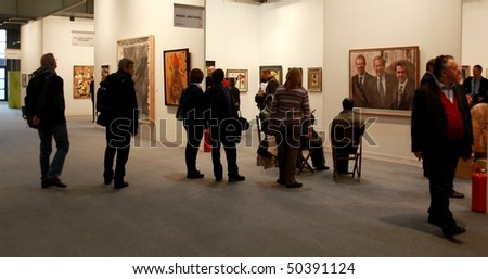 MILAN - MARCH 27: People look at Manel Mayoral work of art at MiArt ArtNow, international exhibition of modern and contemporary art March 27, 2010 in Milan, Italy.