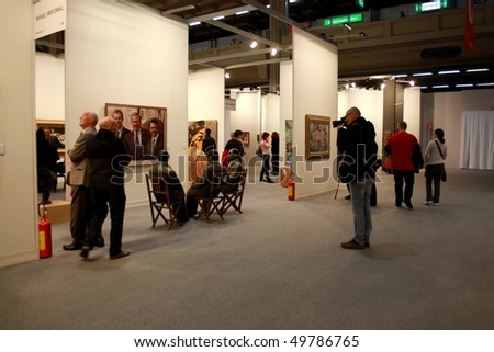 MILAN - MARCH 27: People look at Manel Mayoral works of art at MiArt ArtNow, international exhibition of modern and contemporary art March 27, 2010 in Milan, Italy.