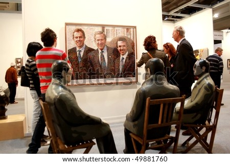 MILAN - MARCH 27: People look at Manel Morela work of art at MiArt ArtNow, international exhibition of modern and contemporary art March 27, 2010 in Milan, Italy.