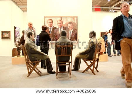 MILAN - MARCH 27: People look at modern works of art at MiArt ArtNow, international exhibition of modern and contemporary art March 27, 2010 in Milan, Italy.