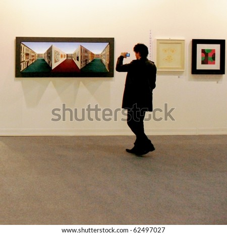MILAN - MARCH 27: People look at painting galleries at MiArt ArtNow, international exhibition of modern and contemporary art March 27, 2010 in Milan, Italy.